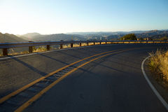 Road through the hills in Malibu at sunset. California Royalty Free Stock Photos