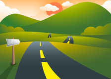 Road on the hills with mountain sunset landscape Stock Photo