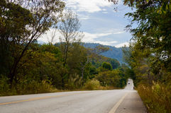 Road through the hills in the Thai Khlong Yai province, Thailand. Asphalt road through the hills in the Thai Khlong Yai province, Thailand Royalty Free Stock Photography