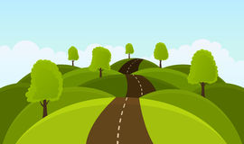Road on hills among trees and meadows. Royalty Free Stock Images
