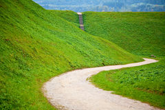 Road and hills at the village Kernave Royalty Free Stock Photo