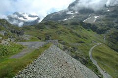 Road on hillside in Alps in Switzerland Royalty Free Stock Photo