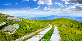 Road on a hillside near mountain peak Royalty Free Stock Photography