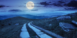Road on a hillside near mountain peak at night Stock Photography