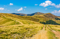 Road through hilly ridge with peaks Stock Photography