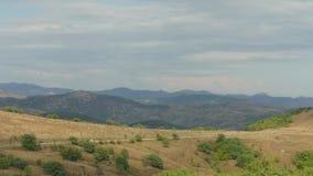 Suburban road through hilly terrain stock video