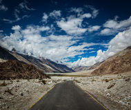Road in Himalayan landscape in Nubra valley in Himalayas Royalty Free Stock Photo