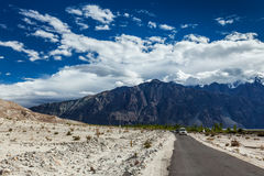 Road in Himalayas with cars Royalty Free Stock Photo