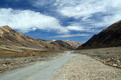 Road through Himalayas. Mesmerising view of Manali Leh highway having mountains with zero vegetations and partially cloudy sky Stock Photography