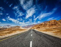 Road in Himalayas with mountains Stock Images