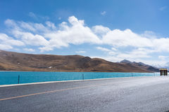 Road and holy lake Stock Image