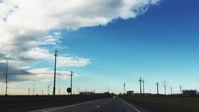 Road horizon. Two lane road going into the horizon with blue sky Royalty Free Stock Images