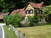 Road House. Old house with pretty garden Stock Image