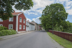 Road with houses in Swedish summer. Road with traditional houses in Swedish summer stock images
