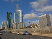 Highrise towers of La Defense busines district, paris, france. Road with huge highrise buildings of La Defense business district behind on a sunny day , paris Stock Photo