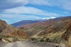 A road ianda snowed mountain Royalty Free Stock Images
