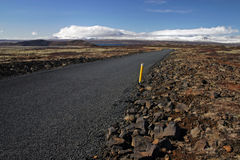 Road on iceland. With blue sky and white clouds royalty free stock photos
