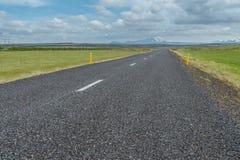 Road in Iceland with Hekla Vulcano. Stock Photo