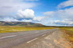 Road in Iceland. Road, lava field around, dramatic sky Stock Photo