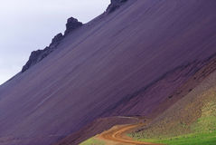 Road of Iceland through rhyolitic scree Royalty Free Stock Images