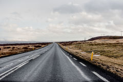 Road in Iceland. Road disappearing in in the horizon in wintery Iceland Stock Photos