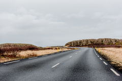 Road in Iceland. Road disappearing in in the horizon in wintery Iceland Royalty Free Stock Photos