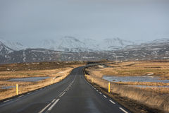 Road in Iceland. Road disappearing in in the horizon in wintery Iceland Royalty Free Stock Photography