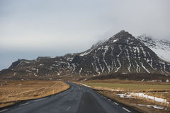 Road in Iceland. Road disappearing in in the horizon in wintery Iceland Stock Photo