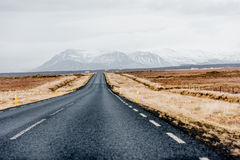Road in Iceland. Road disappearing in in the horizon in wintery Iceland Stock Photography