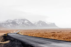 Road in Iceland. Road disappearing in in the horizon in wintery Iceland Stock Image