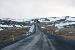 Road in Iceland. Road disappearing in in the horizon in wintery Iceland Stock Images