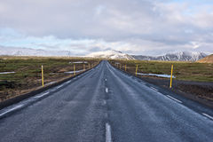 Road in Iceland. Road disappearing in in the horizon in wintery Iceland Royalty Free Stock Photo