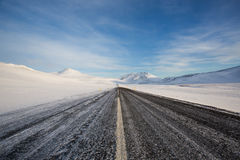 Road in Iceland during Winter. Surrounded by white mountains Stock Photo