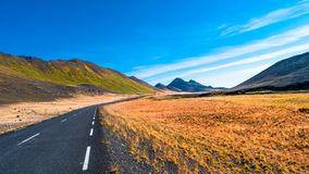 road and Icelandic colorful landscape at Iceland,. Late Summer time, almost Autumn Royalty Free Stock Photography