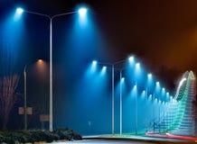 Road illumination at night. Beautiful road with lights at night Royalty Free Stock Photo