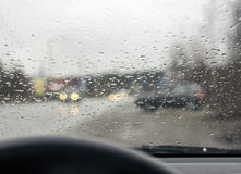 Road from inside car in rainy weather Stock Images