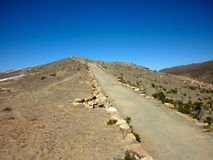Road on Isla del Sol or Island of the Sun on a sunny day located on Lake Titicaca royalty free stock images