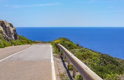 Road on the Island of San Pietro Carbonia-Iglesias, Sardinia, I. View of a panoramic road that descends towards the sea and on the right the guard rail on the Royalty Free Stock Photos