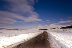 Road into isolation. Road to Altnahara in the Highlands of Scotland with Ben Klibreck on the right hand Stock Photos