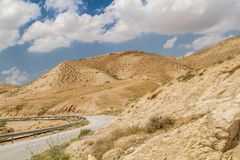 Road in Judaean Desert in the Holy Land, Israel. Road near the monastery of Saint George of Choziba in Judaean Desert in the Holy Land, Israel Royalty Free Stock Images
