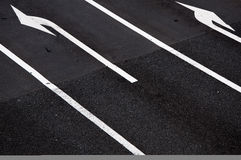 Road Junction. Abstract of road junction showing lane direction arrows Stock Photo