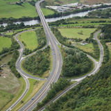 Road junction. Aerial view of road junction beside river Royalty Free Stock Image