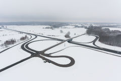 The road junction from above. The road junction in misty winter, view from above Stock Photos