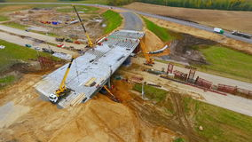 Road junction construction. Top view. Sky view of bridge repair on highway road stock footage