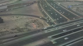 Road junction in Dubai at sunset view from airplane stock footage video. Road junction in Dubai at sunset view from the airplane stock footage video stock video