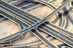 Road junction in Dubai. Two trains and road junction Royalty Free Stock Photos