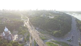 Road junction with heavy traffic in Kyiv, Ukraine. Park of Glory. View from above. Road junction with heavy traffic in Kyiv, Ukraine. View from above. Aerial stock video footage