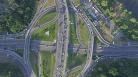 Road junction with heavy traffic in Kyiv, Ukraine. Paton Bridge. View from above. Road junction with heavy traffic in Kyiv, Ukraine. View from above. Aerial view stock footage
