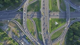 Road junction with heavy traffic in Kyiv, Ukraine. Paton Bridge. View from above stock footage