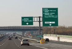 Road junction in the italian motorway. And indication to ROME FLORENCE and more italian place stock image